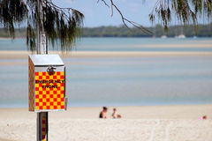 Emergency phone. Queensland beaches present a number of dangers beyond drowning such as crocodiles, stinging jellyfish and shark attacks royalty free stock image