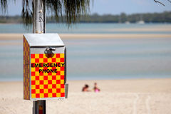 Emergency phone. Queensland beaches present a number of dangers beyond drowning such as crocodiles, stinging jellyfish and shark attacks stock photos