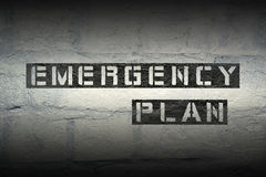Emergency plan gr. Emergency plan stencil print on the grunge white brick wall stock image