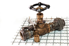 Emergency plumbing repairs. Water taps and two wrenches on the iron grating Stock Photos