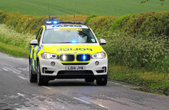 Emergency Police car with blue lights flashing. A Police car in the united Kingdom travelling very fast with the blue lights flashing stock image