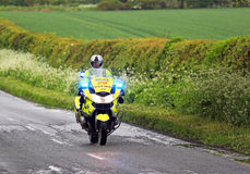 Emergency Police motor cycle with blue lights flashing.. Stock Photography