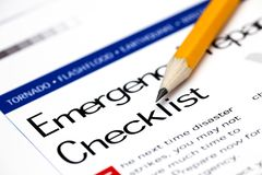 Emergency Preparedness Checklist with yellow pencil. Close-up Royalty Free Stock Photo