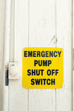 Emergency pump shut off or stop push button switch sign Royalty Free Stock Photo