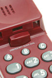 Emergency quick dial buttons. On red phone Stock Photography