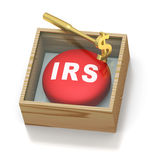 Emergency red pill reminder for IRS. Emergency IRS case with red pill and golden hammer on white background Royalty Free Stock Photo