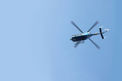 Emergency Rescue Transport Helicopter Flying in Blue Sky Royalty Free Stock Images