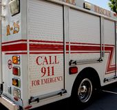 Emergency Response Vehicle. Side panel of emergency response vehicle with call 911 for emergency written on it Stock Photos