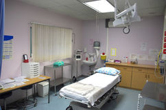 Emergency Room. An emergency room at a hospital with a single bed in the middle under a fluorescent light stock photography