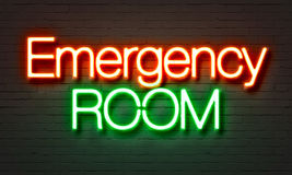 Emergency room neon sign on brick wall background. Stock Images
