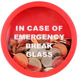 Money Box For Emergency Savings. Money box for emergencies filled with British coins isolated on white background stock photos