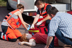 Emergency service helping woman Stock Photo