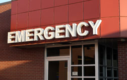 Emergency Sign. In white letters at entrance at hospital Royalty Free Stock Images