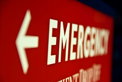 Emergency Sign. An illuminatted arrow sign pointing to the emergency room Stock Photo