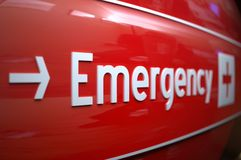 Emergency sign at a hospital. Short focus on an emergency sign at a hospital Stock Photography