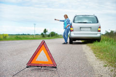 Emergency sign and woman waiting help near her car Stock Photo