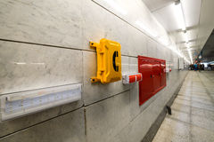 Emergency signs and emergency telephone at the railway station. Royalty Free Stock Images