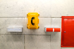 Emergency signs and emergency telephone at the railway station. Stock Photos