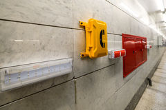 Emergency signs and emergency telephone at the railway station. Stock Photo