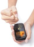 Emergency SMS or MMS received. Man's hand holding a cellphone and making a powerless and shocked fist with his other hand after reception of an SMS text or MMS Stock Image