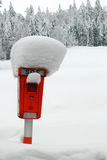 Emergency sos phone box. Snow-covered orange emergency phone box next to road stock photography