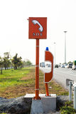 Emergency SOS phone sign and phone box on highway.  royalty free stock photos