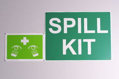 Emergency spill kit wall signs in green on off white background Royalty Free Stock Image