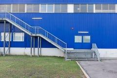 Emergency staircase outside warehouse. Emergency staircase outside blue storage building Stock Images