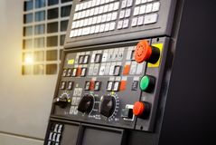 Emergency stop button depth of field, focus blur in CNC machine control panel with machining machine and late process. Emergency stop button depth of field stock image