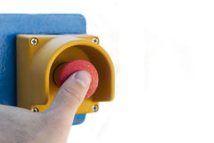 Emergency stop button. Finger pressing emergency stop button Stock Images