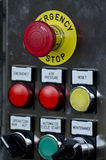 Emergency Stop Button. And other electronic buttons in manufacturing facility royalty free stock photos