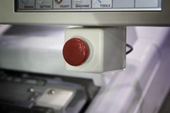 Emergency stop button. Security push switch; selective focus Stock Photo
