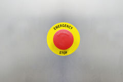 Emergency stop button. On a stainless steel background Royalty Free Stock Image