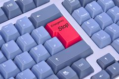 Emergency stop on a computer keyboard. Emergency red stop button on a computer keyboard stock image