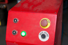 Emergency stop and safety release button in industrial factory Stock Photos