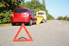 Emergency stop sign with broken car and tow truck. On background. Space for text royalty free stock image