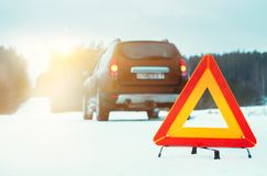 Emergency stop sign and car on winter road. Stock Images