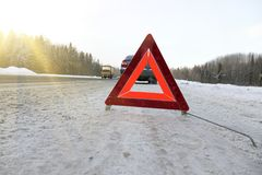 The emergency stop sign. Red sign emergency stop in the snow, on the road royalty free stock image