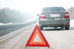 The emergency stop sign. Red sign emergency stop in the snow, on the road stock photos