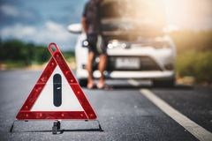 Emergency stop sign and man with broken car stock photography