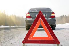 The emergency stop sign. Red sign emergency stop in the snow, on the road stock photo