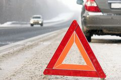 The emergency stop sign. Red sign emergency stop in the snow, on the road stock images
