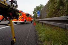 Emergency stretcher stands with a  german firefighting truck on freeway Stock Photography