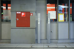Emergency switch and fire hose Stock Images