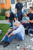 Emergency team giving help to injured man Royalty Free Stock Image