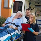 Emergency team treating patient on stretcher Stock Image