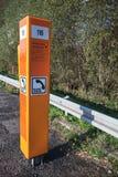 Emergency telephone on the roadside. Chenonceau, France - November 6, 2016: Orange emergency telephone stands on the roadside in France stock photo