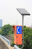 Emergency telephone with solar cell(SOS). Emergency telephone sign with solar cell on the express way side(SOS Stock Photo