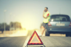 Emergency triangle in the middle of the road. Stock Photo