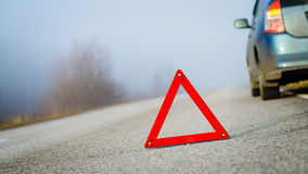 Emergency triangle on the road. Stock Photo